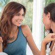 Two Beautiful Women Talking - Stock Photo