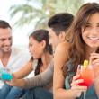 Happy Woman Drinking Cocktail - Stock Photo