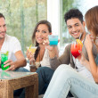 Foto Stock: Happy Group Of Friends Drinking Juice