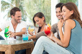 Happy Friends Drinking Juices — Stock Photo