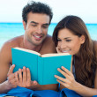 Couple Reading Book At The Beach — Stock Photo