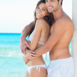 Happy Young Couple At Beach — Stock Photo #18884409