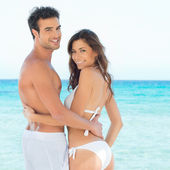 Happy Young Couple At Beach — Foto Stock
