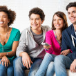 Friends Watching Television — Stockfoto