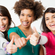 Girls Showing Thumb Up Sign — Stock Photo #22065141