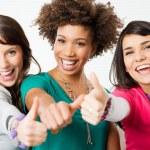 yukarı işareti gösteren kızlar — Stok fotoğraf