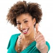 Stock Photo: Portrait Of Young Woman Showing Thumb Up Sign