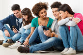 Friends Looking At Cell Phone — Foto Stock