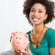Happy Woman Holding Piggybank — Stock Photo #22675187