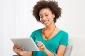 African Woman Looking At Digital Tablet — Stock Photo