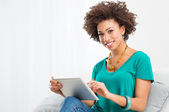African Woman Using Digital Tablet — Stock Photo