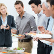 Foto Stock: Business Having Meal Together