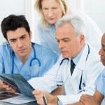 Doctors Examining X-ray Report — Stock Photo