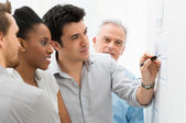 Business Team Analyzing Graph — Stock Photo