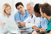 Team Of Doctors Examining Reports — Foto de Stock