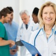 Portrait Of Happy Female Doctor - Stock Photo