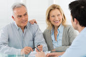 Senior Couple Talking With A Consultant — Foto Stock
