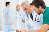Doctors Discussing In Meeting — Stock Photo