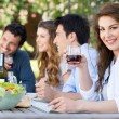 Group Of Friends Eating Outdoors — Stock Photo #28206619