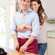 Happy Couple Working In Kitchen — Stock Photo