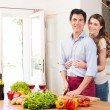 Happy Young Couple Working In Kitchen — Stock Photo #28206851