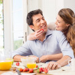 Happy Young Couple Enjoying Breakfast — Stock Photo #28206903