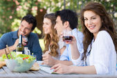Group Of Friends Eating Outdoors — Stock Photo