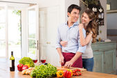 Happy Young Couple Working In Kitchen — Stock Photo