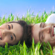 Happy couple lying in the grass — Stock Photo