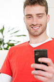 Text messaging with mobile phone — Stock Photo