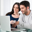 Couple with internet laptop — Stock Photo