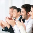 Happy business team clapping hands — Stock Photo