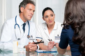 Medical discussion at hospital with patient — Stock Photo