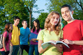 Happy students outdoor — Stock Photo