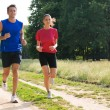 Portrait Of Young Couple Jogging — Stock Photo
