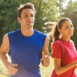 Stock Photo: Young Couple Jogging Together