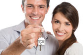 Coupe Holding House Key — Stock Photo