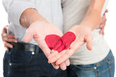 Red Heart Painted On Couple's Hand — Stock Photo