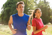 Young Couple Jogging Together — Stock Photo