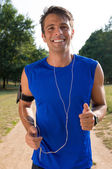 Young Man Jogging While Listening Music — Stock Photo