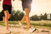 Young Couple Jogging in Park — Stockfoto
