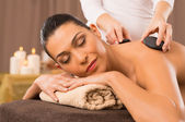 Hot Stone Massage Of A Young Woman — Stock Photo