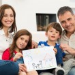 Family with new house drawing — Stock Photo