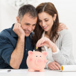 Couple Saving Money — Stock Photo #39422979