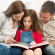 Parents Helping Daughter In Studies — Stock Photo