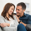 Loving Couple Sitting On Couch — Stock Photo #39423135