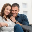 Happy Couple Sitting On Couch — Stock Photo #39423157
