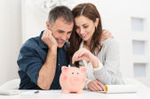 Couple Saving Money — Stockfoto
