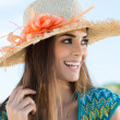 Young WomWearing Floral Straw Hat — Stock Photo #40294435