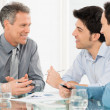 Three Businessmen Discussing In Meeting — Stock Photo #44861029